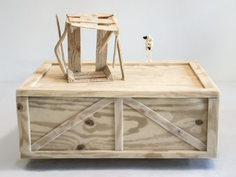 Two Crates with Hanging Skeletons