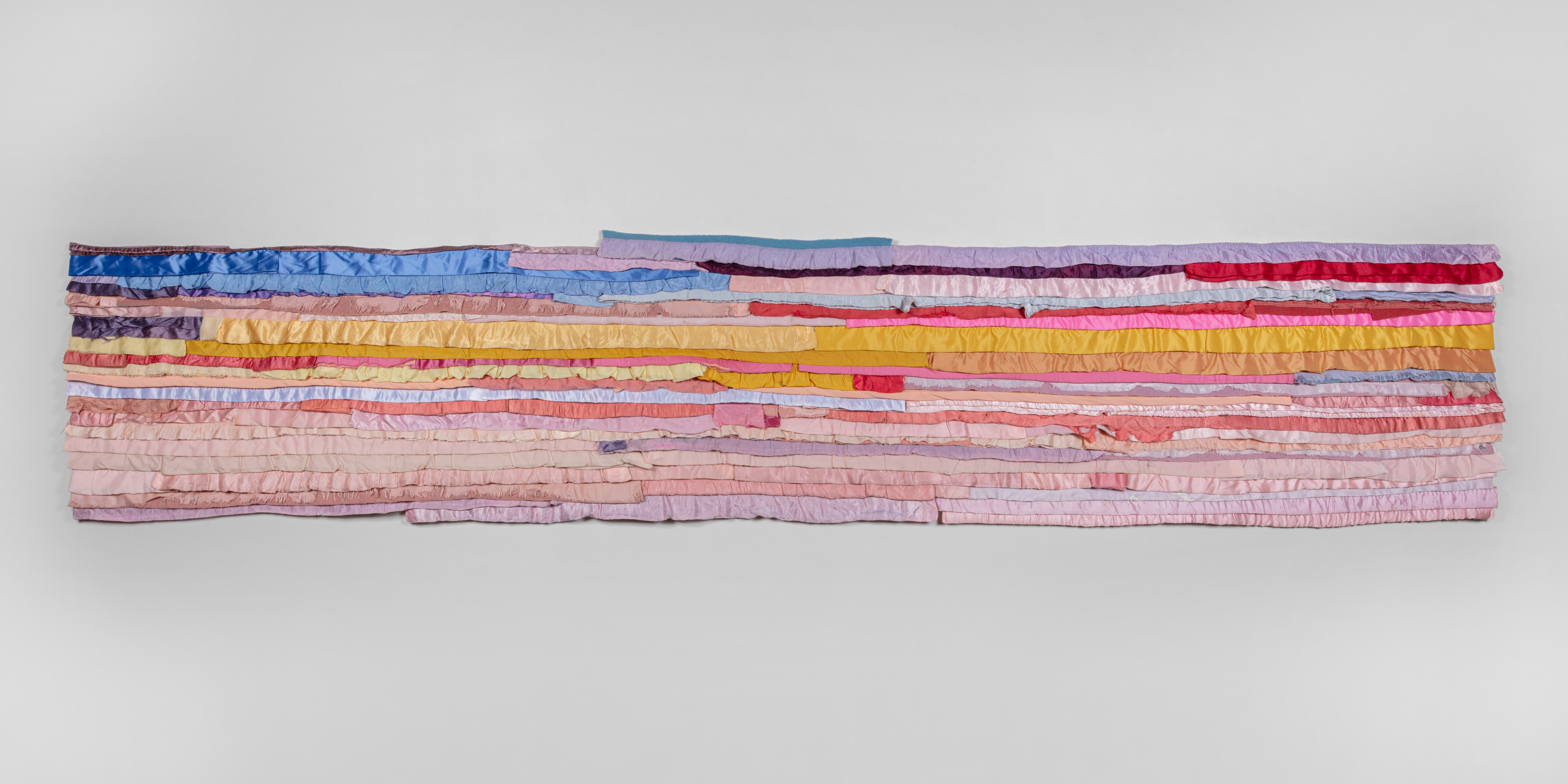 Marie Watt (b. 1967) Reclaimed satin bindings, industrial felt, thread  32.5 x 168 inches  (82.55 x 426.72 cm) Photography by Kevin McConnell - Marc Straus Gallery